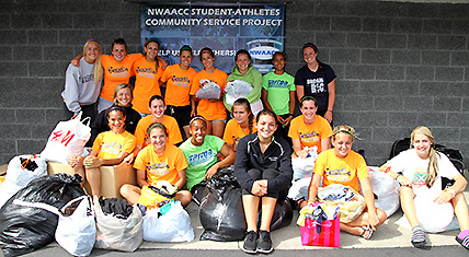 EDCC Womens Soccer team with donated clothing items