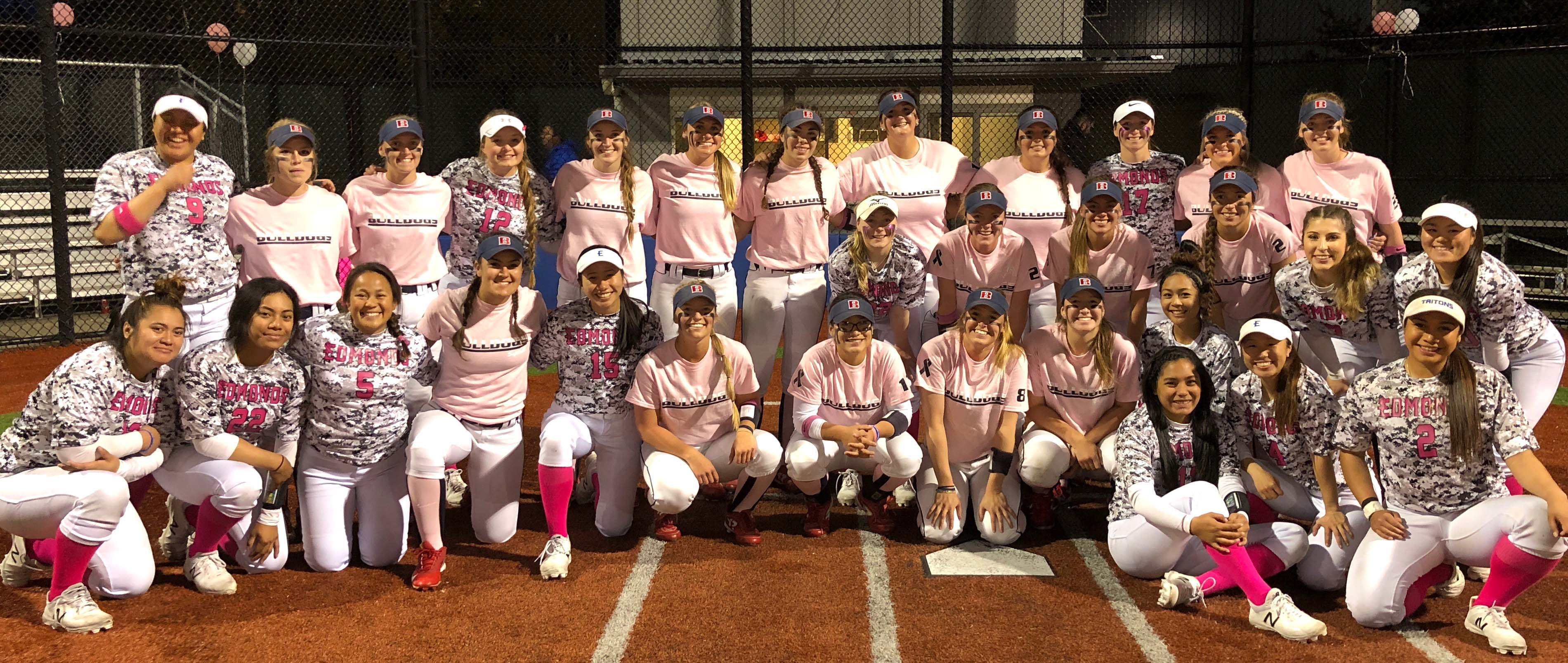 Photo of Edmonds and Bellevue at home plate in pink and camo uniforms