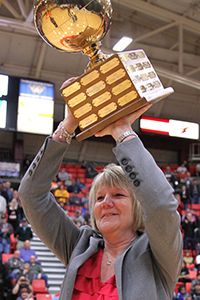 image of Cheryl Holden holding NWAC champiosnship cup over her head