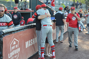 photo of player hugging Levi Lacey during playoff game.
