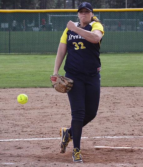 file photo of Scholwinski pitching in a Spokane uniform